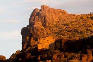 Dawn's light reaches the rock